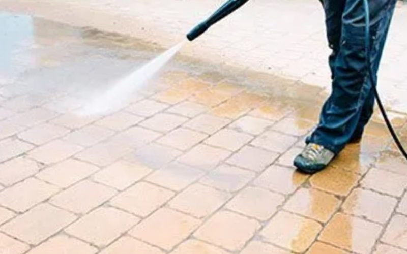 Pressure washing brick walkway