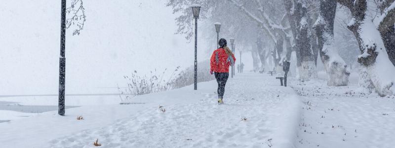 Lady walking in snow
